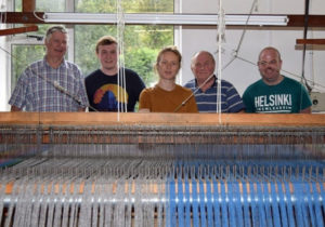 The team of hand weavers at Studio Donegal